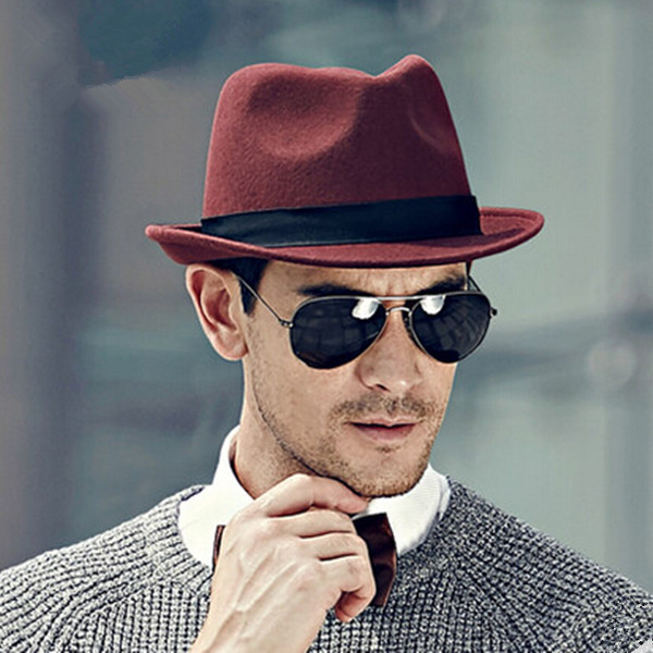 Wine red Fedora hat with classic dimples on the crown. Courtesy of Pinterest  Trendy hat styles for all occasions wine fedora hat men gentleman wool winter hats 12551