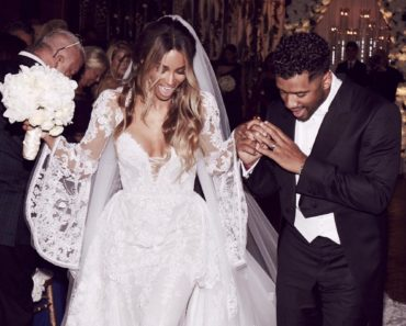 Wedding photo of Ciara and Russell Wilson leaving the church