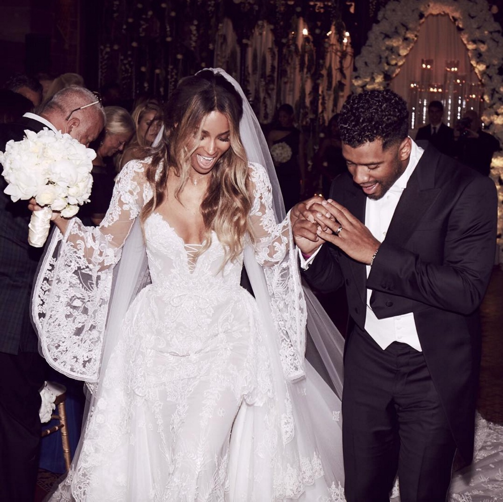 Wedding photo of Ciara and Russell Wilson leaving the church  The Best Looks at Ciara and Russell Wilson's Wedding Ciara and Russell Wilson Wedding