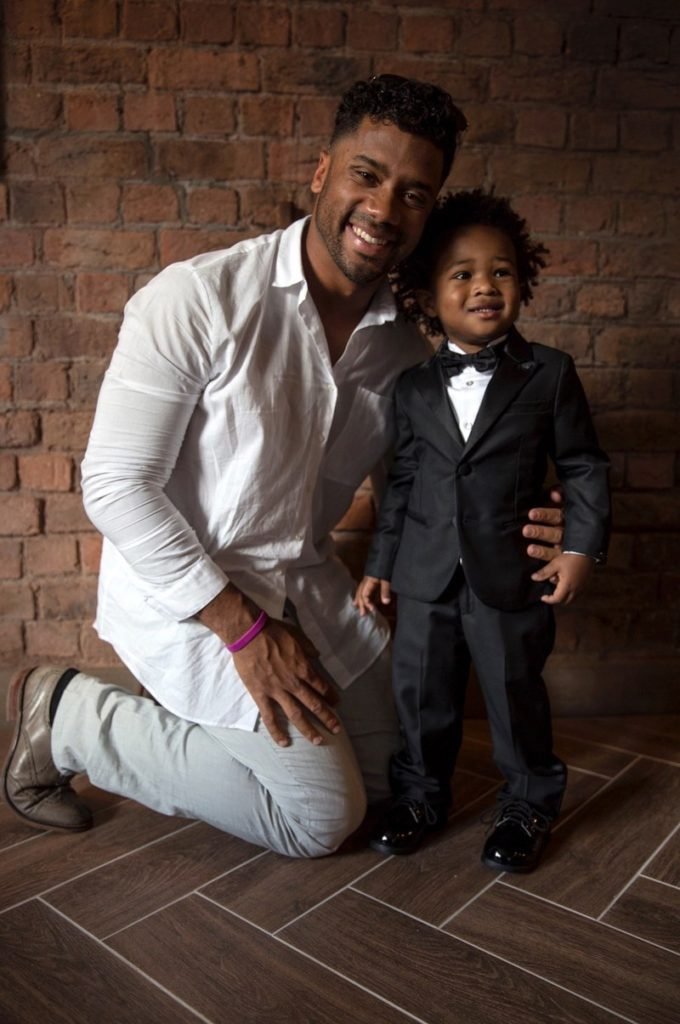 Russell Wilson with step son Future Zahir. Courtesy of GQ  The Best Looks at Ciara and Russell Wilson's Wedding russell wilson wedding future zahir 3