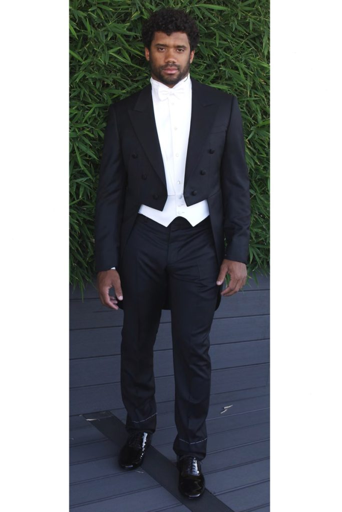 Russell Wilson in his final fitting at Armani. Courtesy of GQ Magazine  The Best Looks at Ciara and Russell Wilson's Wedding russell wilson wedding tux fitting 2
